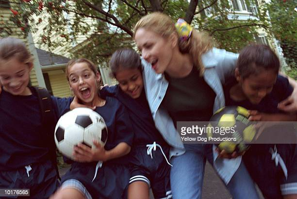 WOMAN WITH GIRL SOCCER TEAM