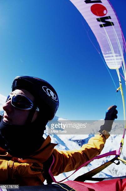 PARAGLIDING PILOT IN FLIGHT