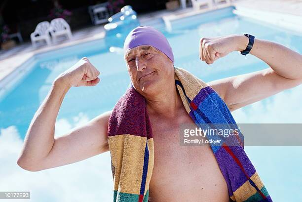 mature man (60-70) posing by pool - showing off stock pictures, royalty-free photos & images