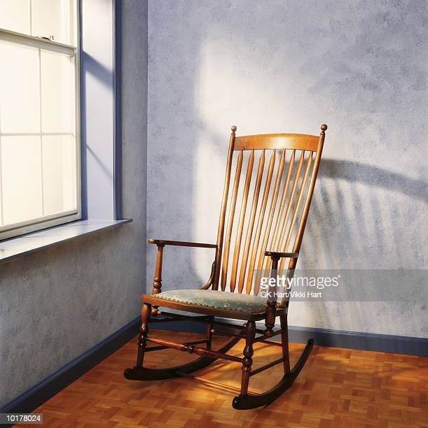 rocking chair near window - rocking chair stock pictures, royalty-free photos & images