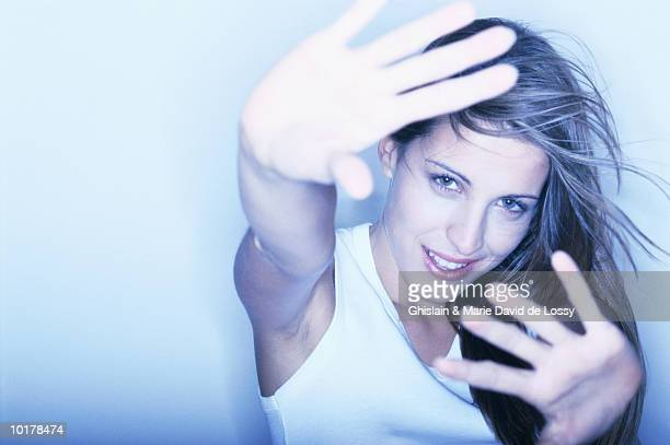 WOMAN W/HANDS HELD OUTWARD
