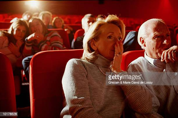 PEOPLE IN MOVIE THEATER