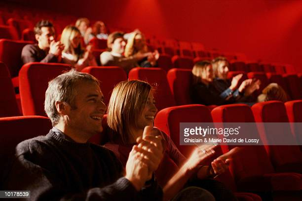 crowd applauding good movie - girlfriends films stock pictures, royalty-free photos & images