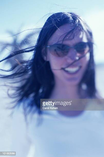 portrait of woman at beach in sunglasses - cross processed stock pictures, royalty-free photos & images