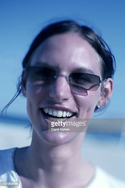 close-up portrait of woman at beach - cross processed stock pictures, royalty-free photos & images
