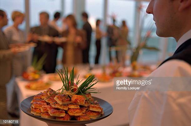 people gathering, waiter with food platter - food service occupation stock pictures, royalty-free photos & images