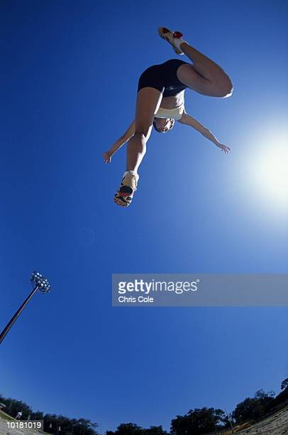 woman mid long jump - women's field event stock pictures, royalty-free photos & images