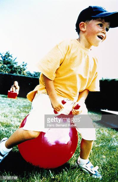 BOY (4-6) PLAYING ON SPACE HOPPER