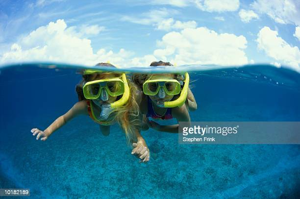 TWO YOUNG GIRLS SNORKELING (CAYMAN)