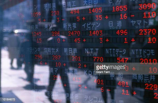REFLECTION OF STOCK READINGS IN WINDOW
