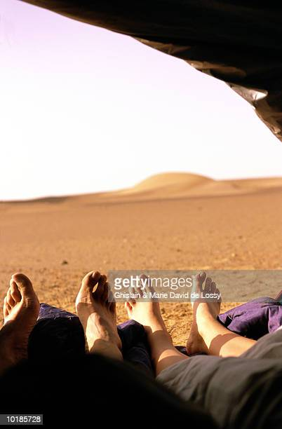 COUPLE LYING IN TENT (FOCUS ON FEET)