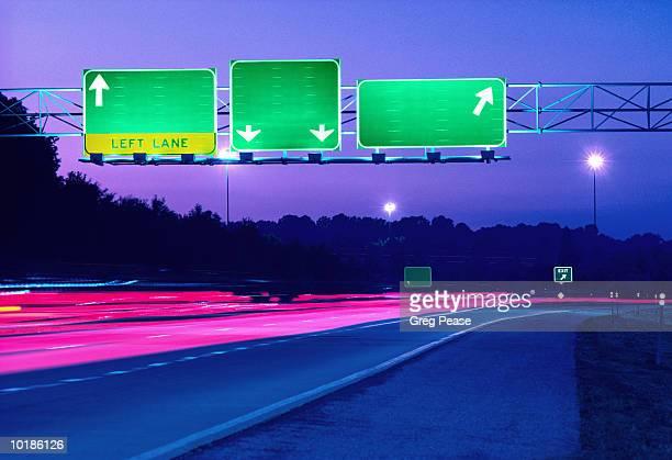 BLANK ROAD SIGNS ON HIGHWAY, DUSK