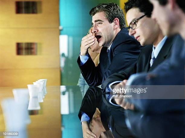 MAN YAWNING IN MEETING