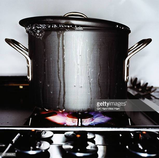 POT ON STOVE BOILING OVER