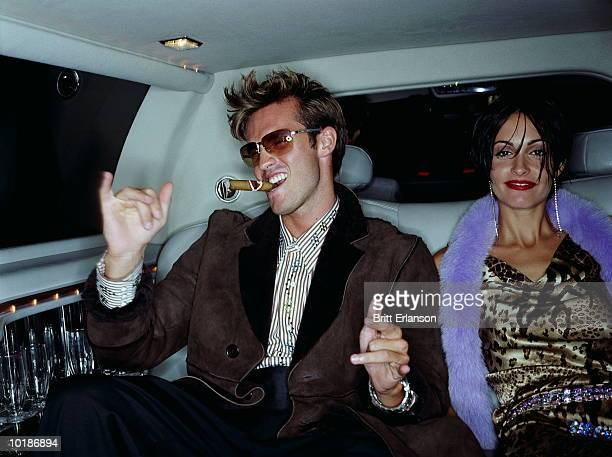 couple in back of car, man with cigar, portrait - exceed and excel stock pictures, royalty-free photos & images