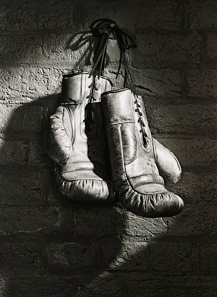 BOXING GLOVES HANGING FROM NAIL (B&W)