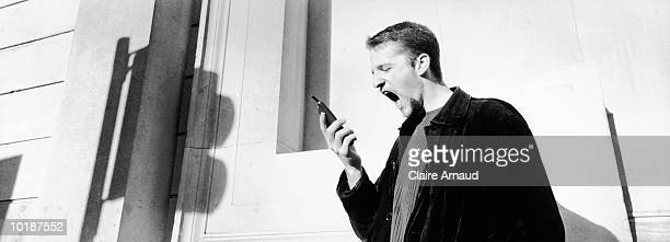 businessman yelling at cell phone - claire castel bildbanksfoton och bilder