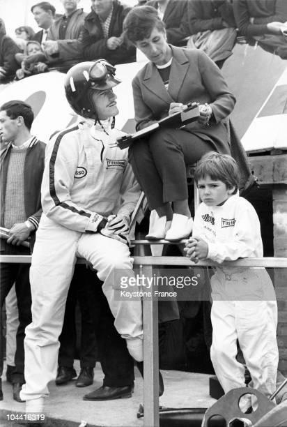 14TH JULY 1967. BRITISH GRAND PRIX. GRAHAM HILL, HIS SON DAMON HILL AND HIS WIFE BRIGITTE