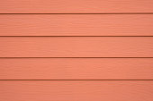WOOD SUBSTITUTE WALL SIDING FOR BACKGROUND , ORANGE COLOR
