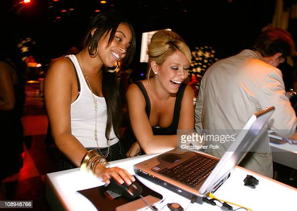 Actress Lauren London and singer Aubrey O'Day attend the Hollywood launch of PlatinumLounge.com at The Globe Theatre on July 7, 2007 in Los Angeles...