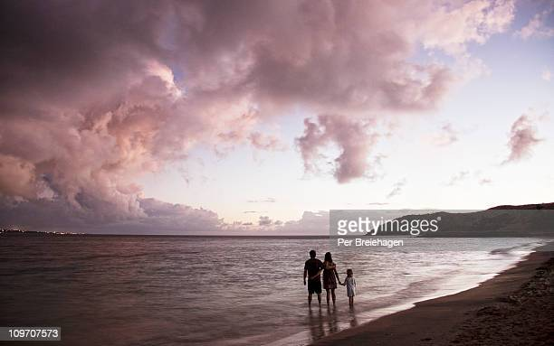 A FAMILY WATCHING CARIBBEAN SUNSET