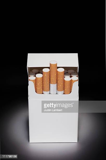 blank cigarette packet in spotlight - cigarette packet stock pictures, royalty-free photos & images