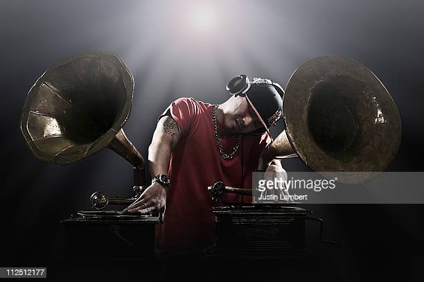 oriental dj using gramophones to mix records with - gramophone stock pictures, royalty-free photos & images