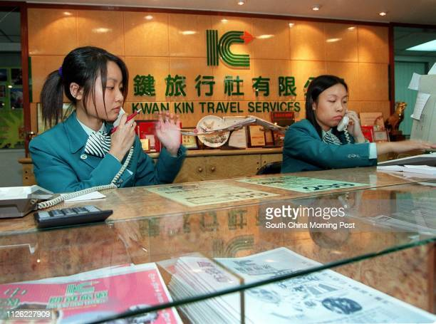 RECEPTIONISTS AT THE HEAD OFFICE OF KWAI KIN TRAVEL SERVICES IN HUNGHOM ANSWER TELEPHONE CALLS FROM FAMILY MEMBERS AND RELATIVES OF THE GROUP OF 16...