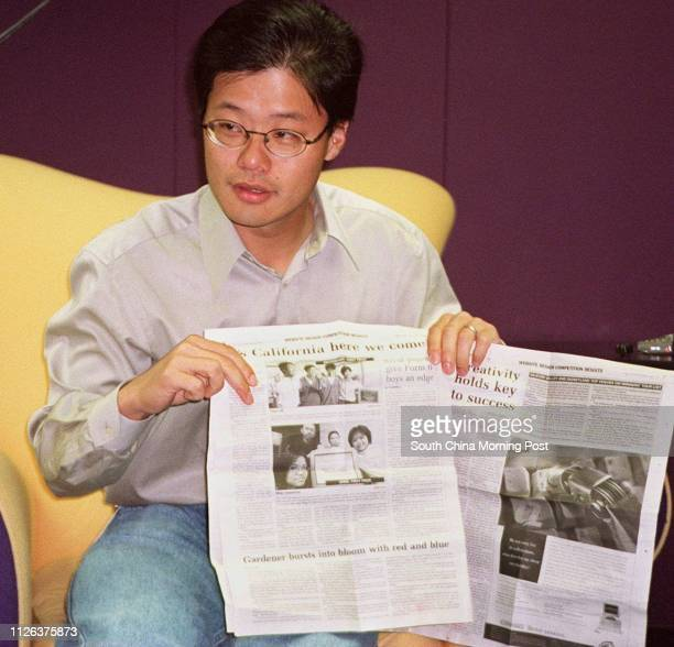 YAHOO! CO-FOUNDER JERRY YANG READS ARTICLES OF THE WEB SITE DESIGN COMPETITION IN HIS OFFICE IN SILICON VALLEY, CALIFORNIA.