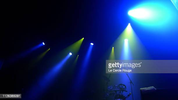 blue light beam during concert. - concert hall stock pictures, royalty-free photos & images
