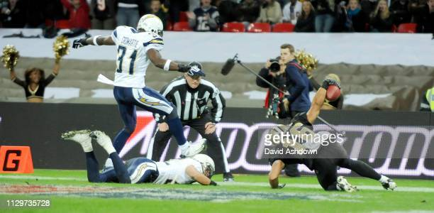 NFL. NEW ORLEANS SAINTS V SAN DIEGO CHARGES AT WEMBLY. . LANCE MOORE 3RD TOUCHDOWN.