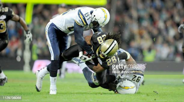 NFL. NEW ORLEANS SAINTS V SAN DIEGO CHARGES AT WEMBLY. . SAINTS 28 USAMA YOUNG DOWN BY NO 92 MARQUES HARRIS AND KASSIM OSGOOD.