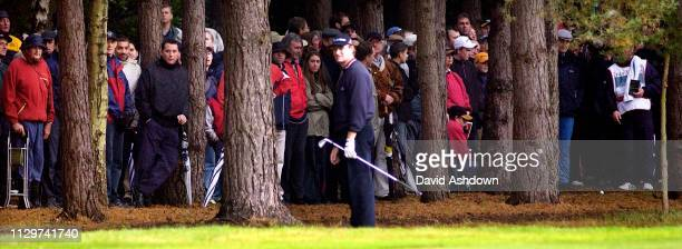 CISCO WORLD MATCH PLAY AT WENTWORTH ELS LOOKS AT HIS 2ND SHOT ON THE 12TH AFTER PUTTING HIS TEE SHOT IN THE TREES DURING HIS MATCH WITH MONTY .