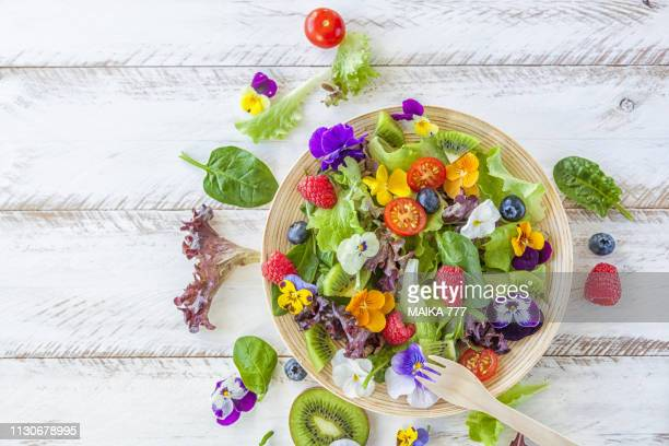 salad with edible flowers - pansy stock pictures, royalty-free photos & images