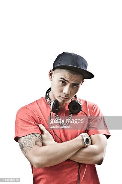 oriental youth with arms crossed - hip hop music stock pictures, royalty-free photos & images