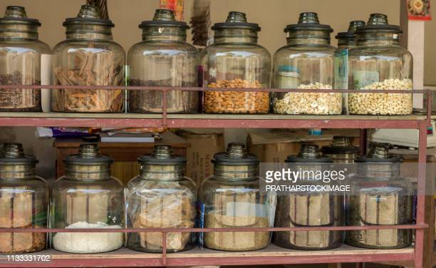 spices kept in glass jar at shop - nuts magazine stock photos and pictures
