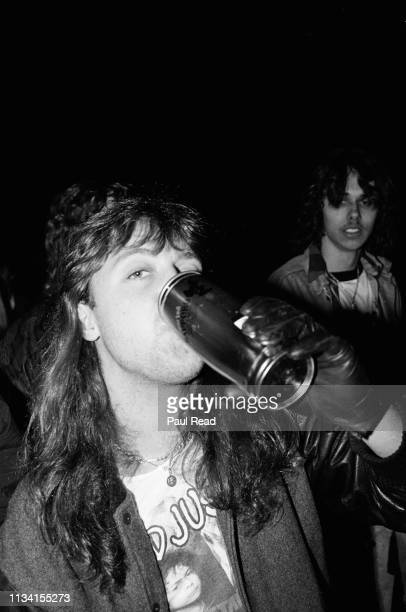 Lars Ulrich of Metallica enjoying a Sapporo beer while meeting fans at the Capital Centre in Landover MD on March 9 1989