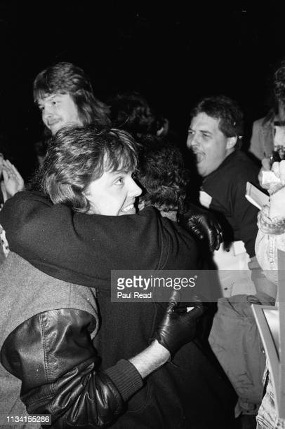 Lars Ulrich of Metallica gets hugged with excited fans surrounding at the Capital Centre in Landover, MD on March 9, 1989.