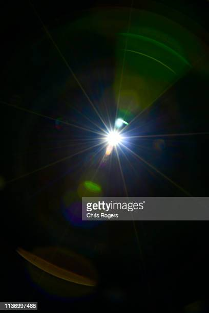 ufo-2 - lens flare stock pictures, royalty-free photos & images
