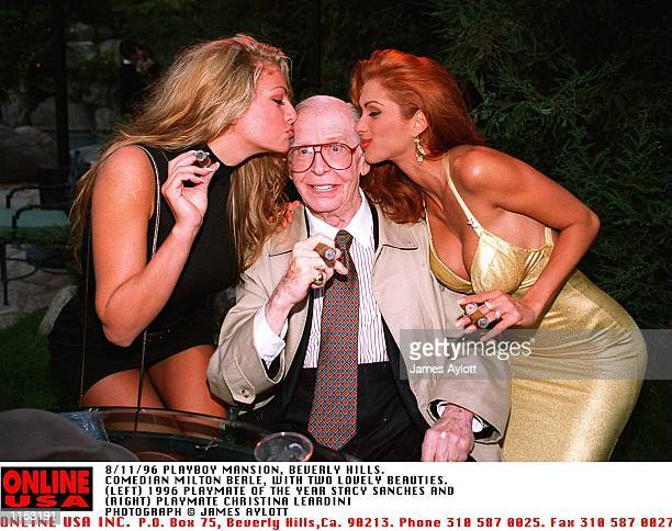 8/11/96 PLAYBOY MANSION BEVERLY HILLS LIVING LEGEND MILTON BERLE GETS A PECK ON THE CHEEK FROM PLAYMATE OF THE YEAR 96 STACY SANCHES AND PAYBOY...