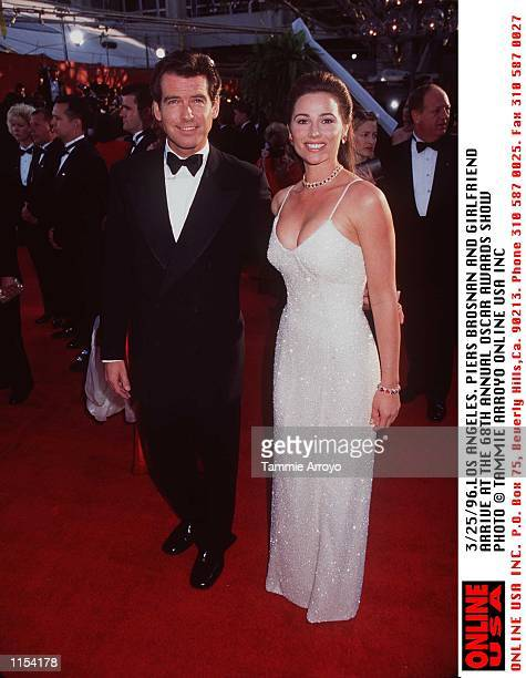 3/25/96 LOS ANGELES DOROTHY CHANDLER PAVILION PIERCE BROSNAN AND HIS GIRLFRIEND KEELY SHAYE SMITH ARRIVE AT THE 68TH ANNUAL AWARDS SHOW