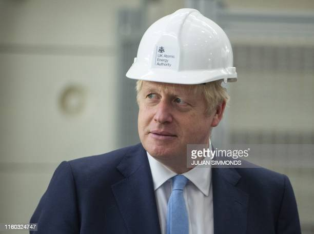 Britain's Prime Minister Boris Johnson gestures during his visit to the Fusion Energy Research Centre at the Fulham Science Centre in Oxfordshire...