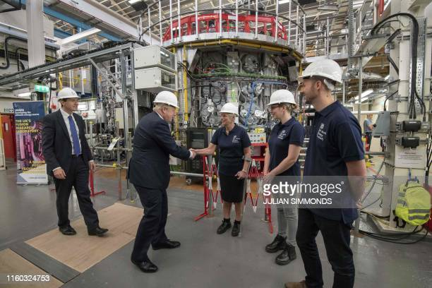 Britain's Prime Minister Boris Johnson meets staff during his visit to the Fusion Energy Research Centre at the Fulham Science Centre in Oxfordshire...