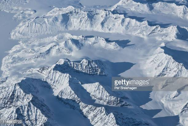 greenland winter peaks and long shadows - arctic stock pictures, royalty-free photos & images