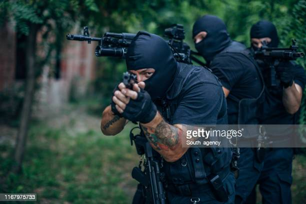 swat - aggression stock pictures, royalty-free photos & images