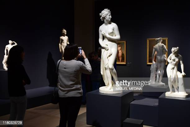 A visitor takes a photo of Neoclassical marble sculpture Venus by Italian sculptor Antonio Canova on November 6 2019 during the exhibition Canova /...