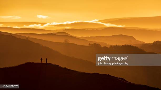 lake district - autumn - activity - sunrise - orange - people - england - autumn stock pictures, royalty-free photos & images