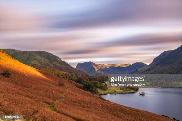 buttermere - crummock water - fleetwith pike - lake district - sunset - autumn - english lake district stock pictures, royalty-free photos & images