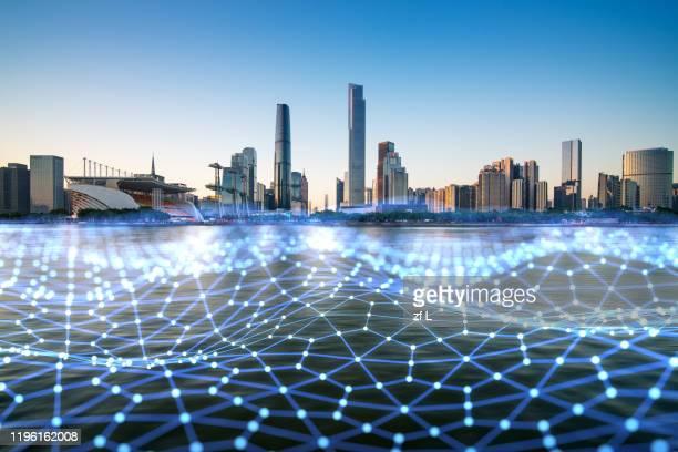 藍色網格線的城市天際線 - スマートシティ ストックフォトと画像