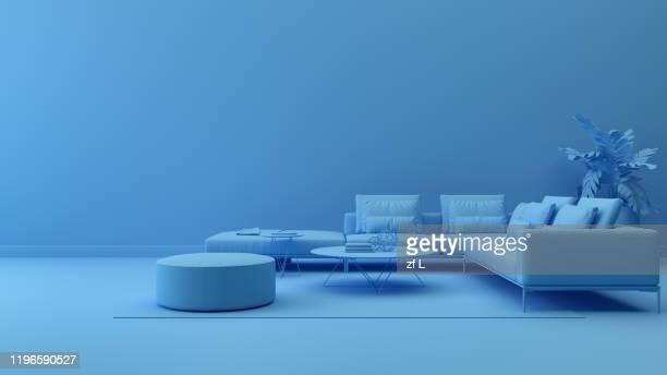 藍色有沙發的室內空間 - imagen minimalista fotografías e imágenes de stock